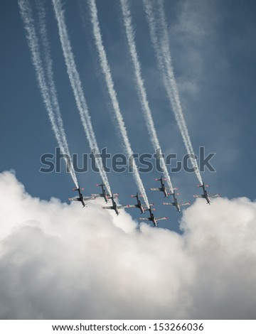 RADOM, POLAND - AUGUST 24: Orlik (Poland) aerobatic display team during Air Show 2013 event on August 24, 2013 in Radom, Poland