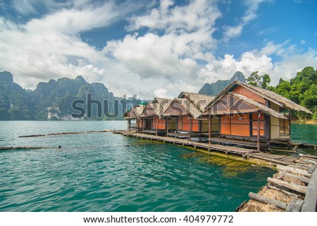 Raft House and Mountain Landscape in Peaceful View of Ratchaprapa dam , Khao sok national park , Surat thani ,Thailand(Un-focus image)