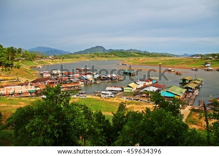 Raft houses at the edge of the dam in Thailand