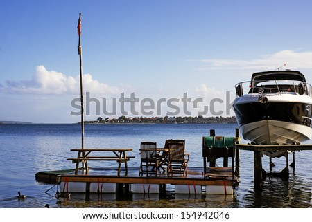 Raft with chairs and tables and a Danish flag. - stock photo