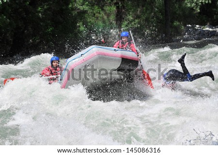 Rafting as extreme and fun team sport - stock photo