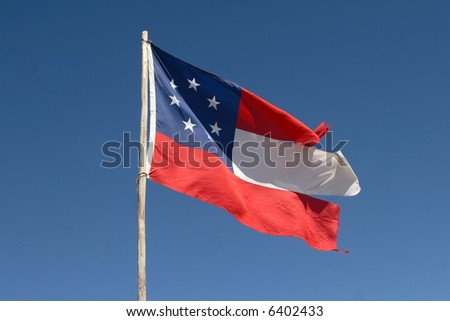 Ragged first national Confederate Flag - the original Stars & Bars was replaced by the more noted Stars & Bars because the original was difficult to differentiate from the Stars & Stripes in battle. - stock photo