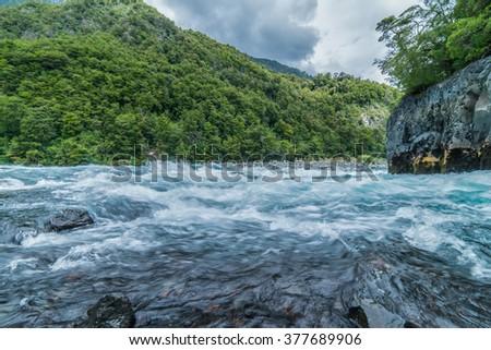 Raging Patagonia River Rapids near Puerto Varas Chili & Volcano Osorno - stock photo