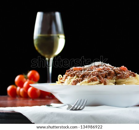 Ragu alla bolognese is a complex sauce which involves a variety of cooking techniques, including sweating, sauteing and braising. - stock photo