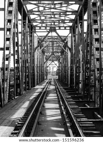 Rail length across the river on steel bridge, black and white photo - stock photo