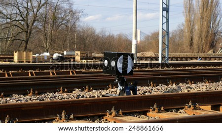 Rail lights on the tracks in sunny day - stock photo