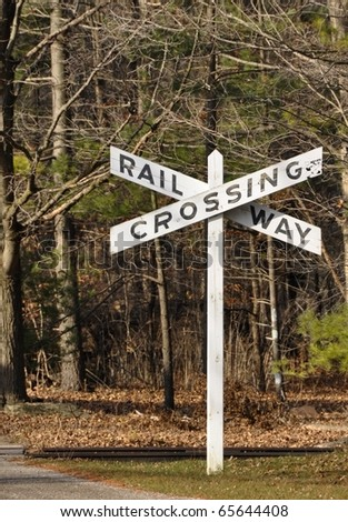 rail road crossing sign in a rural area - stock photo