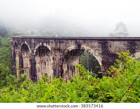 Rail road Demodara Nine Arch Bridge morning mist, Gotuwala, Ella, Sri Lanka - stock photo