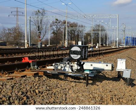 Rail siding and tracks in sunny day - stock photo