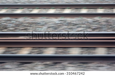 Rail tracks speeding past - stock photo