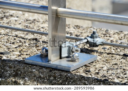 Railing Fastenings on a Concrete Wall - stock photo