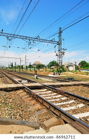 Railroad and pedestrian crossing. Against the background of blue sky. - stock photo