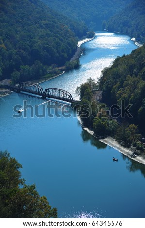 Railroad bridge crossing the new river from Eagles Nest State Park, WV - stock photo