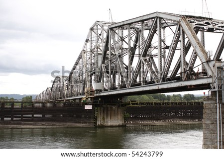 Railroad bridge over river.