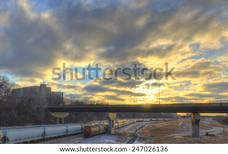 Railroad Cars on tracks with dramatic sky - stock photo