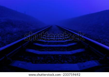 railroad closeup in night with moon light - stock photo