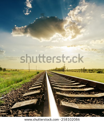 railroad closeup with reflections under sunset - stock photo