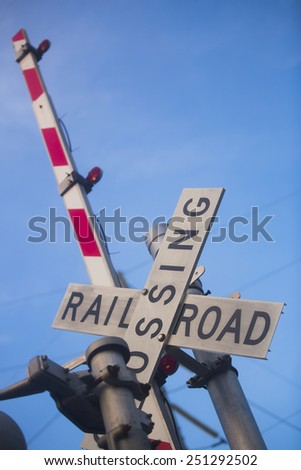 railroad crossing sign and sunrise sky macon, georgia - stock photo