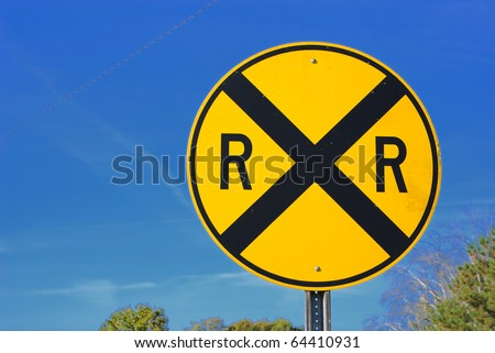 Railroad crossing street sign - stock photo