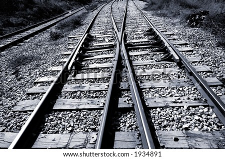 Railroad junction - two railroads converging - black & white - stock photo