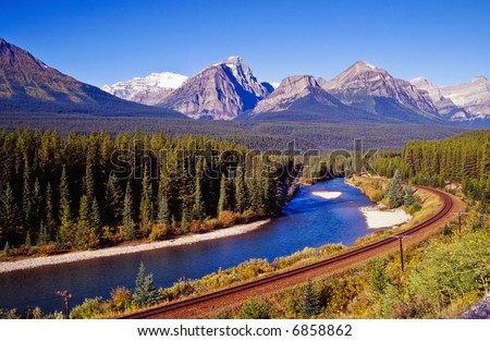 Railroad on the riverbanks to Bow River - stock photo