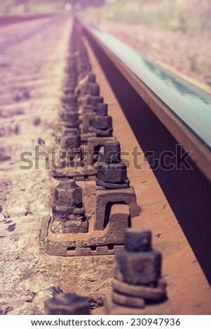 railroad rail receding into the distance - stock photo