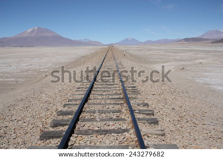 Railroad to nowhere in a stone desert, Uyuni, Bolivia - stock photo