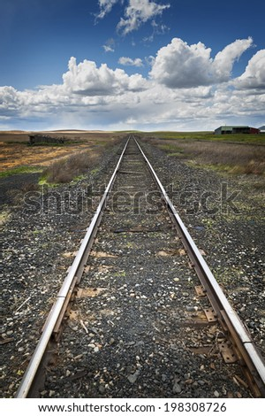 Railroad to Nowhere. Railroad tracks lead straight to the horizon in this scene in the Palouse area of eastern Washington state.