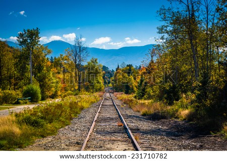Railroad track and distant mountains seen in White Mountain National Forest, New Hampshire. - stock photo