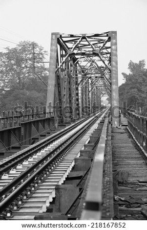 Railroad track on steel bridge with concrete supporting the rail. - stock photo