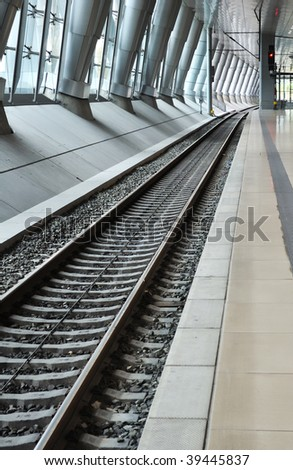 Railroad track perspective in a train station