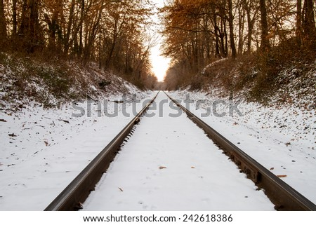Railroad tracks covered in snow. - stock photo