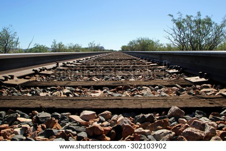 Railroad Tracks Go on for Miles in West Texas - stock photo