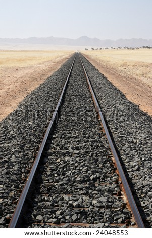 Railroad tracks in the desert in Namibia - stock photo