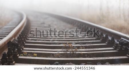 Railroad tracks in the fog - stock photo