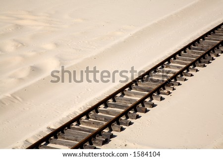 Railroad tracks on the sand. - stock photo