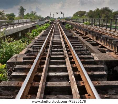 Railroad tracks parallel transport - stock photo
