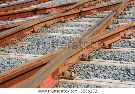Railroad tracks with gravel - stock photo