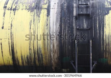 Railroad train of black tanker cars transporting crude oil on the tracks. - stock photo