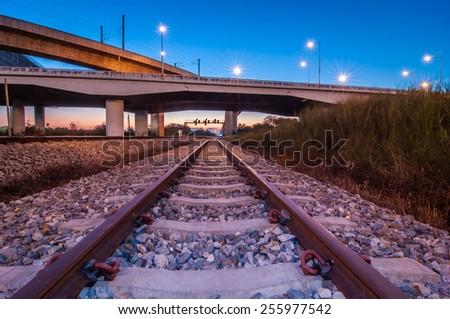 railroad under motorway road. - stock photo