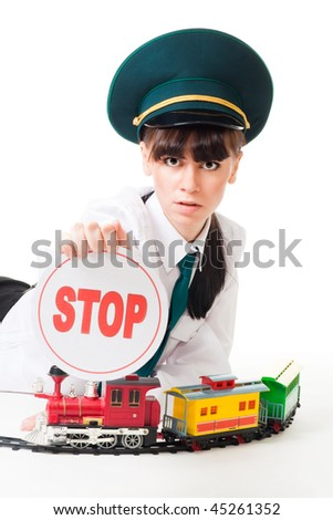 Railroad worker with stop sign and toy locomotive