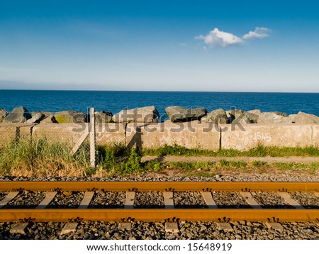 Rails on the sea background - stock photo