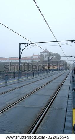 Rails over dom Luiz bridge, Porto, Portugal - stock photo