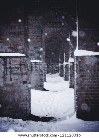 Railway arches in snow - stock photo