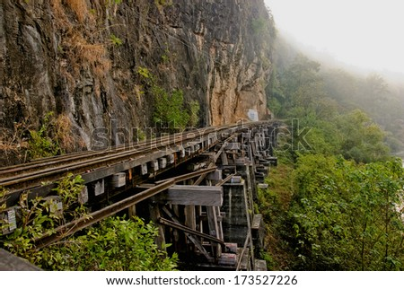 Railway beside the river in Thailand  - stock photo