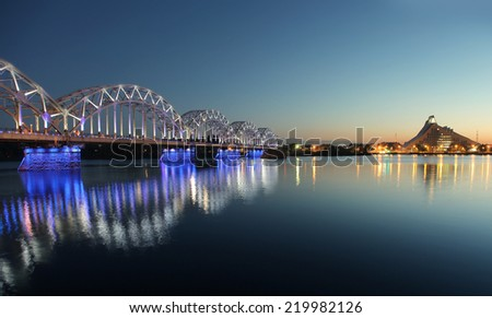 Railway bridge at night in Riga, Latvia