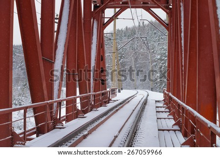 Railway bridge in winter - stock photo