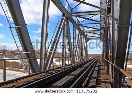 railway bridge through freeze river - stock photo