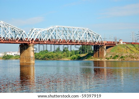 railway bridge with freight train over the Volga river, Russia - stock photo