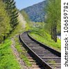 Railway disappears in the mountains - stock photo